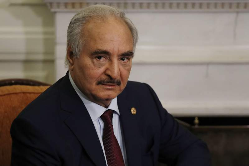 FILE - In this Jan. 17, 2020, file, photo, Libyan Gen. Khalifa Hifter joins a meeting with the Greek Foreign Minister Nikos Dendias in Athens. The U.S. military Tuesday, May 26, 2020 accused Russia of deploying fighter planes to conflict-stricken Libya to support Russian mercenaries aiding east-based forces in their offensive on the capital, Tripoli. (AP Photo/Thanassis Stavrakis, File)