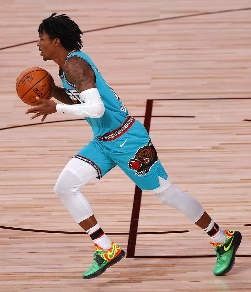 Ja Morant of the Memphis Grizzlies' dribbles the ball down court during the first half of an NBA basketball game Sunday, Aug. 9, 2020, in Lake Buena Vista, Fla. (Kevin C. Cox/Pool Photo via AP)