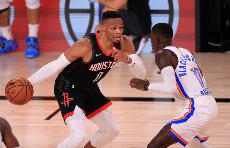 LAKE BUENA VISTA, FLORIDA - SEPTEMBER 02: Russell Westbrook #0 of the Houston Rockets drives the ball against Dennis Schroder #17 of the Oklahoma City Thunder during the third quarter in Game Seven of the Western Conference First Round during the 2020 NBA Playoffs at AdventHealth Arena at ESPN Wide World Of Sports Complex on September 02, 2020 in Lake Buena Vista, Florida. NOTE TO USER: User expressly acknowledges and agrees that, by downloading and or using this photograph, User is consenting to the terms and conditions of the Getty Images License Agreement. (Photo by Mike Ehrmann/Getty Images)