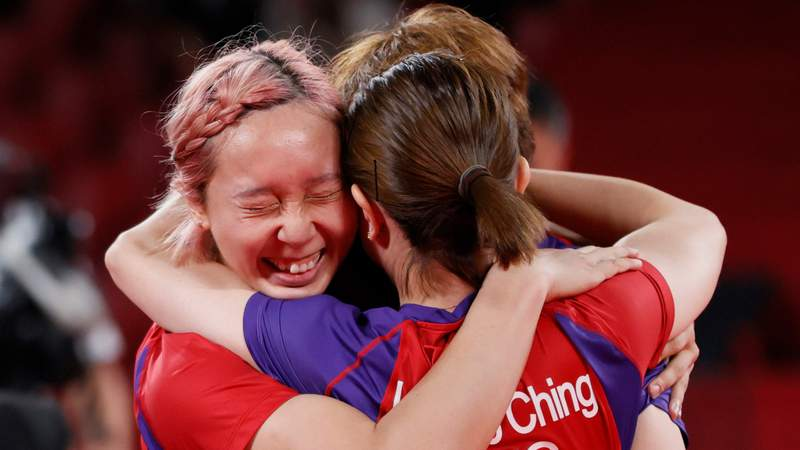 Minnie Soo (L) of Team Hong Kong is hugged by her teammates after winning her Women's Team Bronze Medal table tennis match on day thirteen of the Tokyo 2020 Olympic Games at Tokyo Metropolitan Gymnasium on August 05, 2021 in Tokyo, Japan.