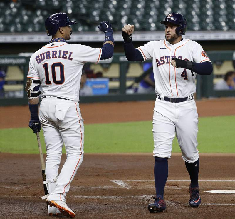 HOUSTON, TEXAS - SEPTEMBER 02: George Springer #4 of the Houston Astros high fives Yuli Gurriel #10 as he scores on a two-run home run by Michael Brantley #23 against the Texas Rangers at Minute Maid Park on September 02, 2020 in Houston, Texas. (Photo by Bob Levey/Getty Images)