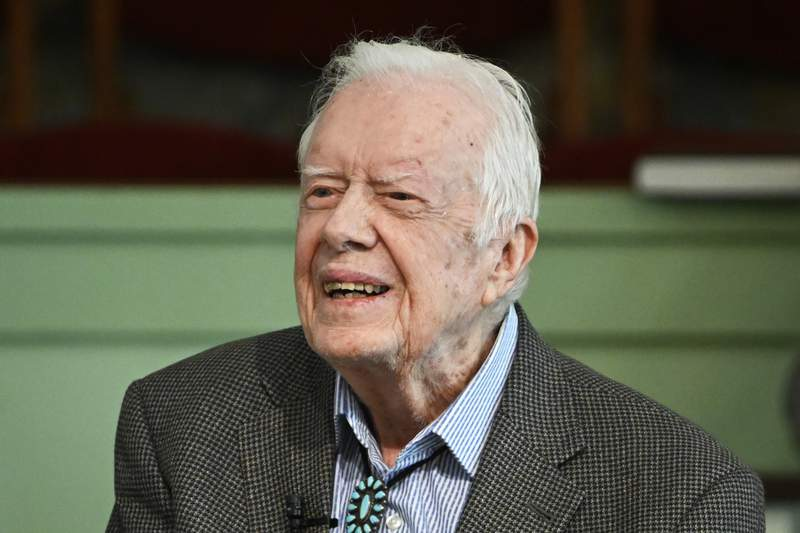 FILE - In this Nov. 3, 2019, file photo, former President Jimmy Carter teaches Sunday school at Maranatha Baptist Church in Plains, Ga.  Nearly a year into the pandemic, Carter and his wife have returned to one of their favorite things: church. Maranatha Baptist Church in tiny Plains, Ga., announced on its Facebook page Wednesday, Feb. 24, 2021,  that the 96-year-old Carter and Rosalynn Carter are again attending worship in person.  (AP Photo/John Amis, File)