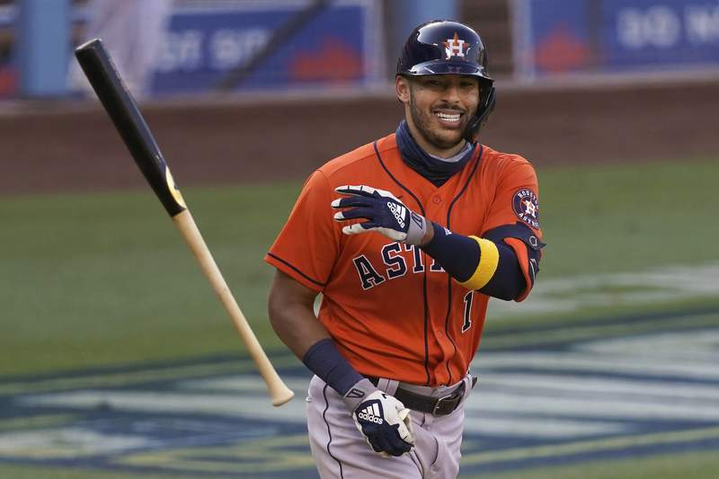 FILE - Houston Astros' Carlos Correa smiles after drawing a walk against the Oakland Athletics during the ninth inning of Game 2 of a baseball American League Division Series in Los Angeles, in this Tuesday, Oct. 6, 2020, file photo. Correa is among roughly 125 players who entered Friday, Jan. 15, 2021, eligible to exchange salary arbitration figures with their teams.(AP Photo/Ashley Landis, File)