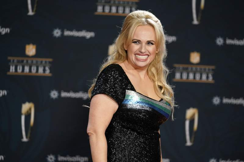 FILE - In this Tuesday, Feb. 2, 2021, file photo, Rebel Wilson poses on the red carpet during the NFL Honors football awards show, in Los Angeles. Wilson returns to her roots as host of ABC's Pooch Perfect, an eight-episode series featuring 10 dog groomers and their assistants competing in challenges. The show, which debuts March 30, is based on an Australian version. (AP Photo/Marcio Jose Sanchez, File)