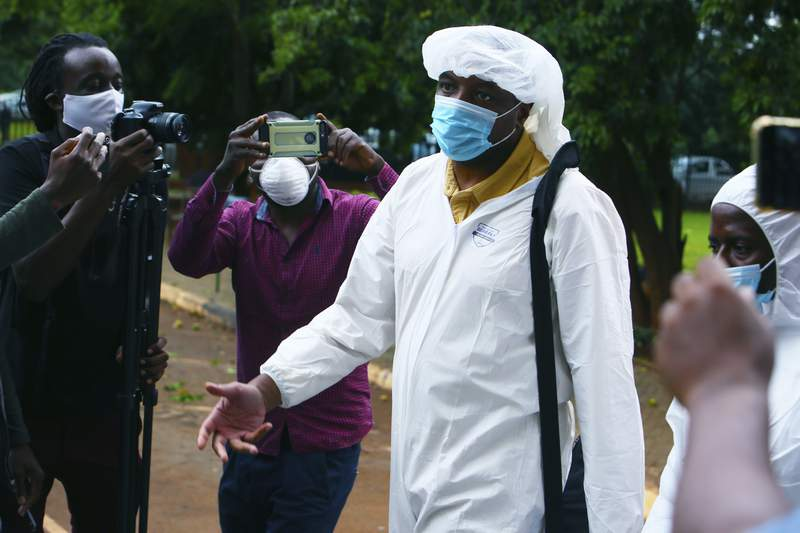 Zimbabwean journalist Hopwell Chin'ono arrives at the magistrates courts in Harare, Saturday, Jan. 9, 2021. On Friday, Zimbabwe police arrested the prominent journalist for the third time in six months. Chinono posted on his Twitter account that police had picked him from his house and said they were charging him with communicating falsehoods.  (AP Photo/Tsvangirayi Mukwazhi)
