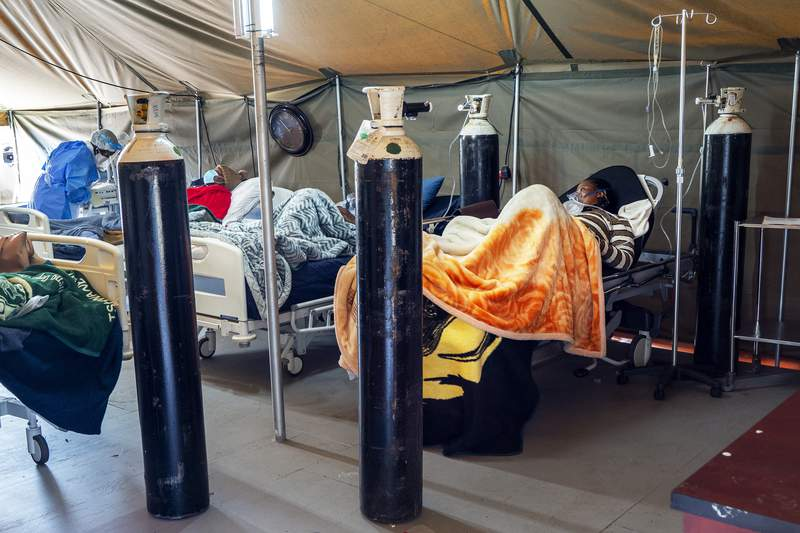 FILE - This July 10, 2020 file photo shows Covid-19 patients being treated with oxygen at the Tshwane District Hospital in Pretoria, South Africa. South Africa has exceeded 500.000 confirmed COVID-19 cases, representing more than 50% of all reported cases in Africa's 54 countries. Health Minister Zwelini Mkhize announced the new total on Saturday, Aug. 1, 2020. (AP Photo/Jerome Delay, File)