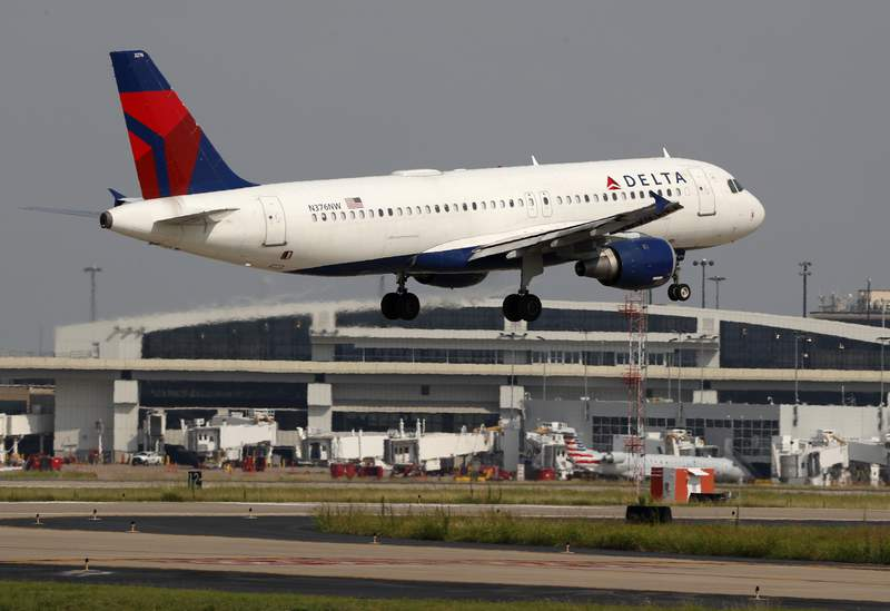 FILE - A Delta Airlines aircraft makes its approach at Dallas-Fort Worth International Airport in Grapevine, Texas, in this Monday, June 24, 2019, file photo. Delta Air Lines reported its first quarterly profit since the pandemic devastated the airline industry more than a year ago, as hordes of vacation travelers and money from U.S. taxpayers offset weak corporate and international travel. Delta said Wednesday, July 14, 2021, that it earned $652 million in the second quarter. However, Delta's report shows that airlines still face turbulence as they try to rebound from their worst year ever.(AP Photo/Tony Gutierrez, File)