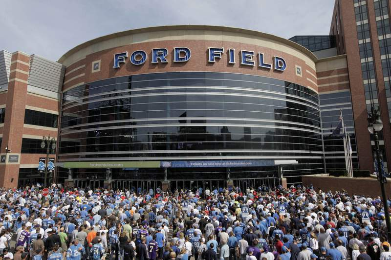 FILE - Fans arrive to Ford Field before and NFL football game between the Detroit Lions and Minnesota Vikings in Detroit, in this Sept. 20, 2009, file photo. The Detroit Lions say Ford Field can be at full capacity this season, a year after the public did not have access to games during the pandemic. The Lions announced Monday, July 12, 2021, the decision was made in large part because of Michigan's steady COVID-19 vaccination rate. (AP Photo/Paul Sancya, File)