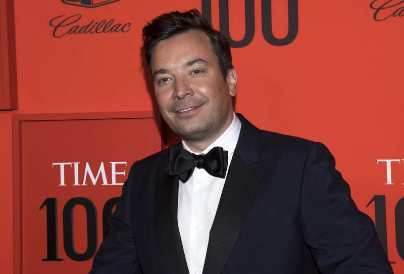 """FILE - In this April 23, 2019 file photo, Jimmy Fallon attends the Time 100 Gala in New York.  Fallon and the """"Tonight Show Starring Jimmy Fallon"""" show have returned to their New York City studio for the first time since the coronavirus epidemic shut down much of television. He recorded Monday's show in the studio along the show's band, the Roots, but without an audience. Guests like New York Gov. Andrew Cuomo were interviewed remotely.  (Photo by Charles Sykes/Invision/AP, File)"""