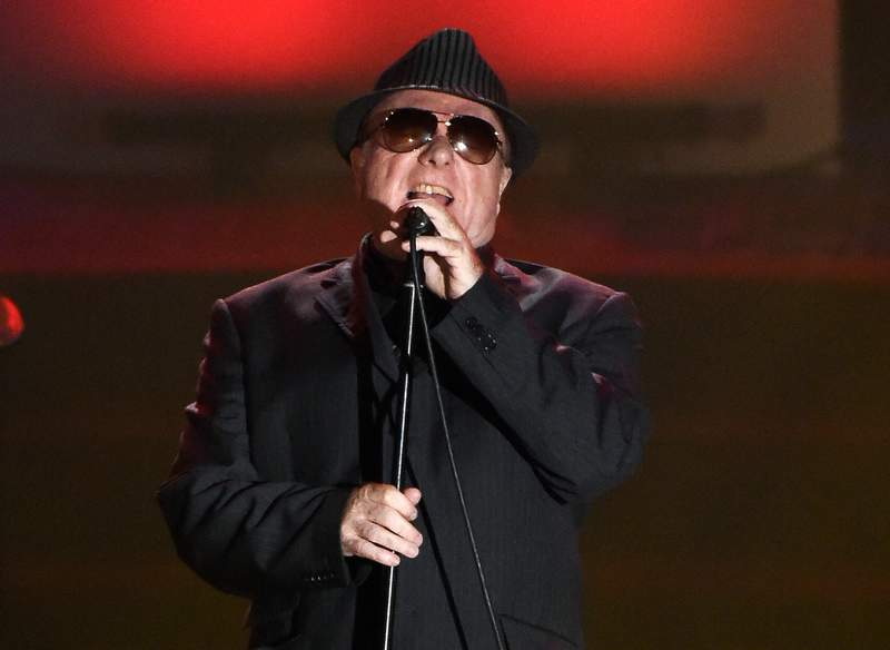 FILE - In this June 18, 2015 file photo, Van Morrison performs at the 46th annual Songwriters Hall of Fame Induction and Awards Gala in New York. Van Morrison is to release three new songs over the coming weeks that take a swipe at the lockdown restrictions imposed by the British government. In No More Lockdown, the Northern Irishman says the curbs enslave people, effectively labels the government as fascist bullies, condemns celebrities for telling us what we are supposed to feel and charges scientists for making up crooked facts. (Photo by Evan Agostini/Invision/AP, File)