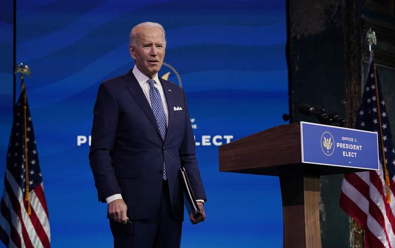 President-elect Joe Biden pauses as he leaves to listen to a reporter's shouted question at The Queen Theater in Wilmington, Del., Tuesday, Dec 22, 2020. (AP Photo/Carolyn Kaster)