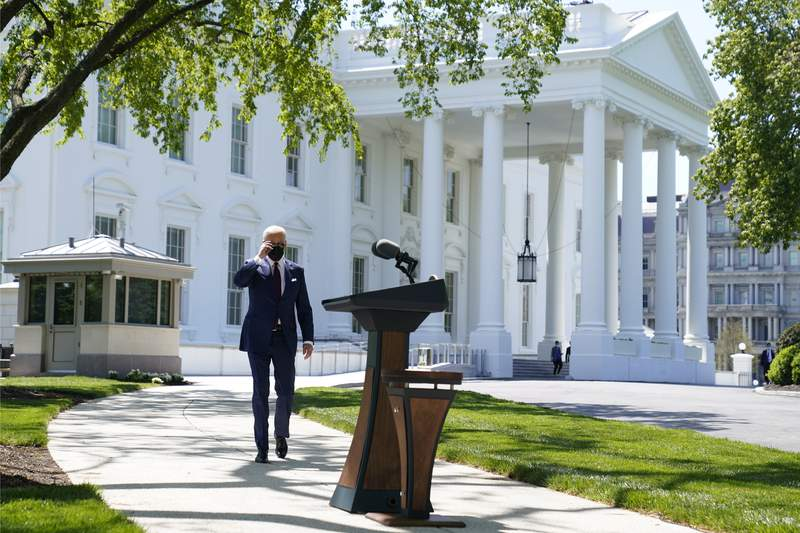 President Joe Biden arrives to speak about COVID-19, on the North Lawn of the White House, Tuesday, April 27, 2021, in Washington. (AP Photo/Evan Vucci)
