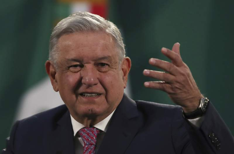 Mexican President Andrs Manuel Lpez Obrador gives his daily morning press conference following a two-week absence after he tested positive for coronavirus, at the presidential palace, Palacio Nacional, in Mexico City, Monday, Feb. 8, 2021. (AP Photo/Marco Ugarte)