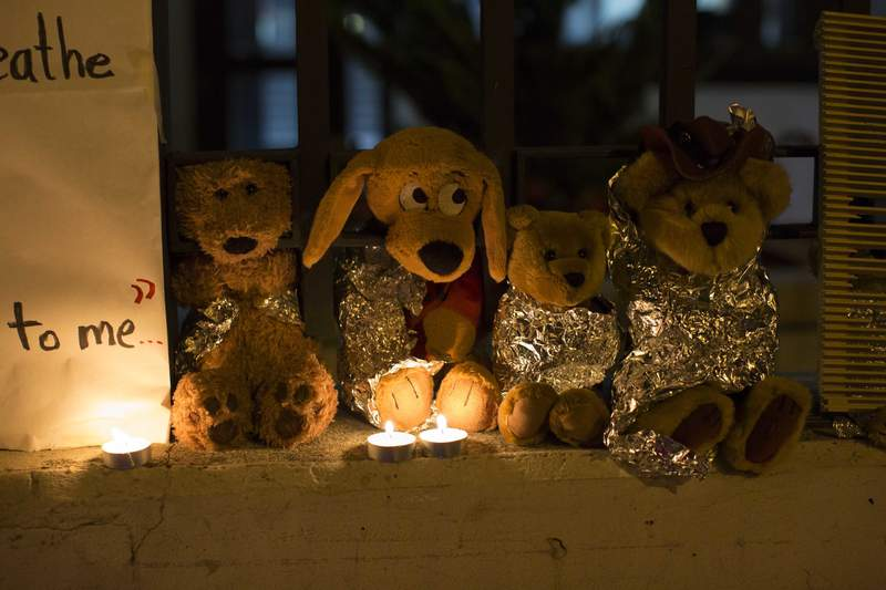 FILE - In this Wednesday, June 20, 2018, file photo, stuffed toy animals wrapped in aluminum foil representing migrant children separated from their families are displayed in protest in front of the United States embassy in Guatemala City. In a report released Tuesday, June 8, 2021, the Biden administration says it has identified more than 3,900 children separated at the border under former President Donald Trumps zero-tolerance policy on illegal crossings. (AP Photo/Luis Soto, File)