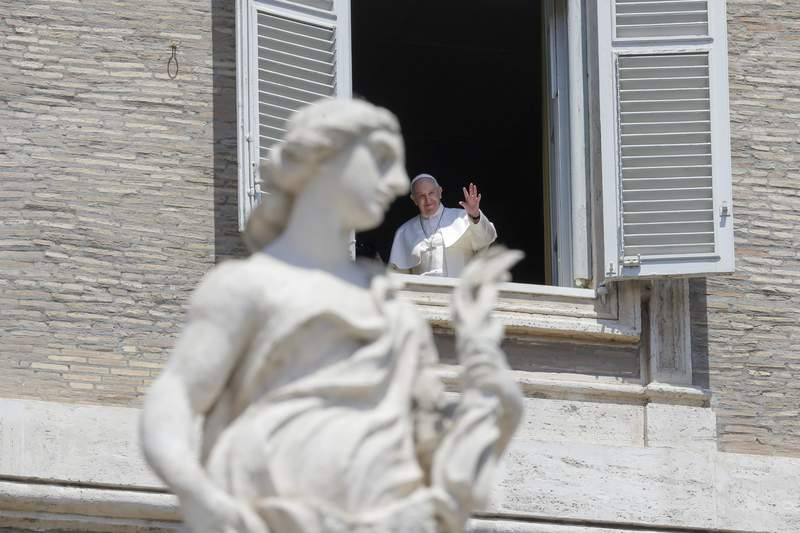 Pope Francis delivers his blessing from the window of his studio overlooking St. Peter's Square, at the Vatican, Sunday, May 24, 2020. For the first time in months, well-spaced faithful gathered in St. Peters Square for the traditional Sunday papal blessing, casting their gaze at the window where the pope normally addresses the faithful, since the square had been closed due to anti-coronavirus lockdown measures. (AP Photo/Andrew Medichini)