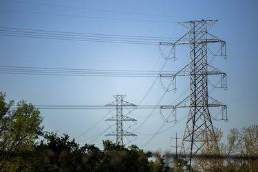 Electrical power lines in Austin.                    Credit: Eddie Gaspar/The Texas Tribune
