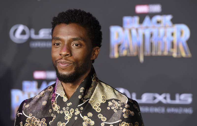 """FILE - In this Jan. 29, 2018 file photo, Chadwick Boseman, a cast member in """"Black Panther,"""" poses at the premiere of the film in Los Angeles. Boseman, who played Black icons Jackie Robinson and James Brown before finding fame as the regal Black Panther in the Marvel cinematic universe, died of colon cancer on Aug. 28, 2020 in Los Angeles. He was buried on Sept. 3, in Belton, South Carolina, about 11 miles from his hometown of Anderson, according to a death certificate obtained Monday, Sept. 14  by The Associated Press. (Photo by Chris Pizzello/Invision/AP, File)"""