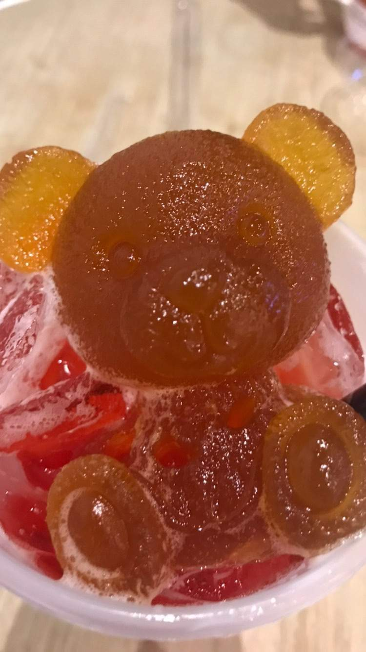 A mango teddy bear jelly rests on a bed of iced raspberry green tea at TeaTalk in Houston
