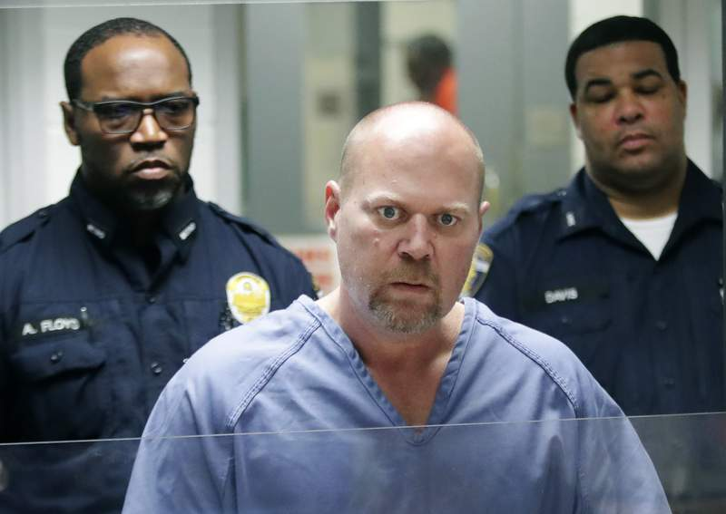 FILE - In this Oct. 25, 2018, file photo, Gregory Bush is arraigned on two counts of murder and 10 counts of wanton endangerment in Louisville, Ky. Bush, already serving a life prison sentence for fatally shooting two shoppers at a grocery store, has pleaded guilty to federal hate crimes. Federal prosecutors say the October 2018 shootings at a Kroger outlet in Louisville were racially motivated. (Scott Utterback/Courier Journal via AP, Pool, File)