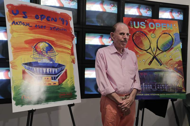 FILE - In this Wednesday June 14, 2017, file photo is artist Peter Max at the unveiling of art he created for the 2017 U.S. Open tennis tournament in New York. A New Jersey appeals court has ruled against Max in a dispute over millions of dollars' worth of his works that were damaged in a warehouse during Superstorm Sandy. (AP Photo/Julie Jacobson, File)