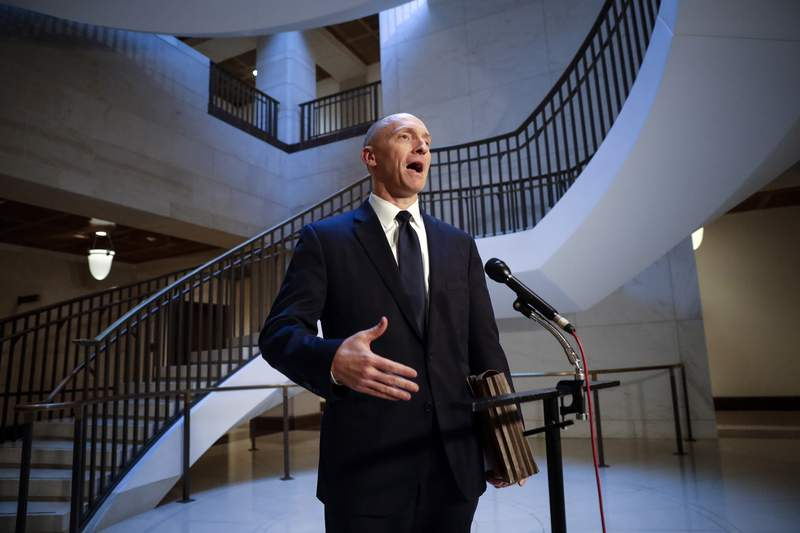 """FILE - In a Nov. 2, 2017, file photo, Carter Page, a foreign policy adviser to Donald Trump's 2016 presidential campaign, speaks with reporters following a day of questions from the House Intelligence Committee, on Capitol Hill in Washington. The Justice Department has concluded that it should have ended its surveillance of a former Trump campaign adviser earlier than it did because it lacked insufficient predication"""" to continue eavesdropping. That's according to an order made public Thursday by a secretive intelligence court. The FBI obtained a warrant in 2016 to eavesdrop on former Trump national security aide Carter Page on suspicions that he was secretly a Russian agent. The Justice Department renewed the warrant three times, including during the early months of the Trump administration. But the Justice Department's inspector general has harshly criticized the FBI's handing of those applications.(AP Photo/J. Scott Applewhite, File)"""
