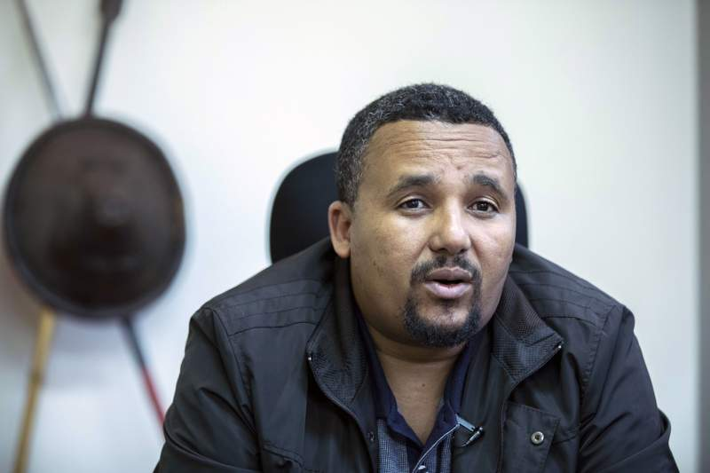 FILE - In this Thursday, Oct. 24, 2019 file photo, opposition politician Jawar Mohammed speaks with The Associated Press at his house in Addis Ababa, Ethiopia. Lawyers representing jailed Ethiopian opposition politicians including Jawar Mohammed, Bekele Gerba, Hamza Adane and Dejene Tafa say they are concerned for the lives of their clients, whose hunger strike has gone on for nearly a month and drawn international attention as they protest their treatment by the government. (AP Photo/Mulugeta Ayene, File)