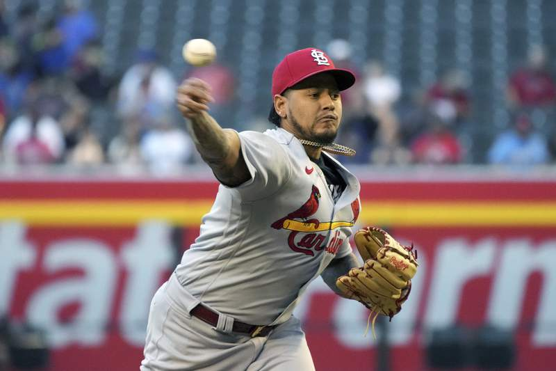 St. Louis Cardinals pitcher Carlos Martinez throws against the Arizona Diamondbacks in the first inning during a baseball game, Thursday, May 27, 2021, in Phoenix. (AP Photo/Rick Scuteri)