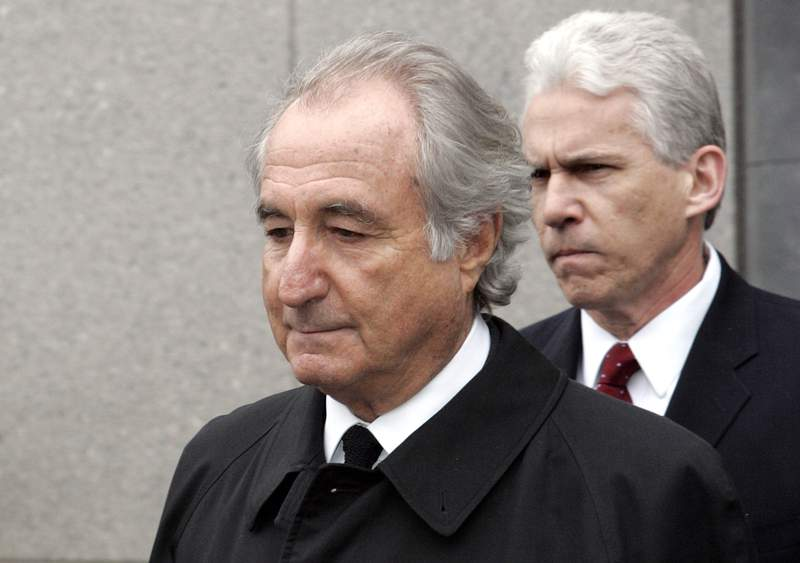 FILE - In this Tuesday, March 10, 2009, file photo, former financier Bernie Madoff exits federal court in Manhattan, in New York. Madoff asked a federal judge Wednesday, Feb. 5, 2020, to grant him a compassionate release from his 150-year prison sentence, saying he has terminal kidney failure and less than 18 months to live. (AP Photo/David Karp, File)