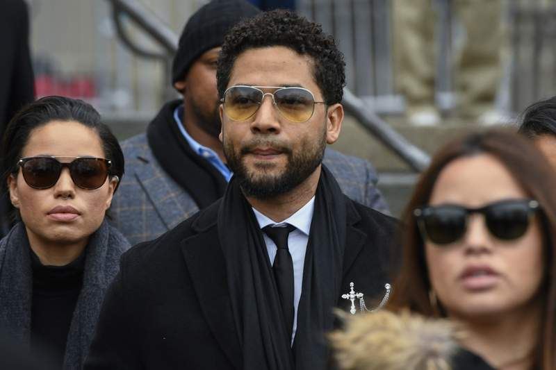 """FILE - In this Feb. 24, 2020 file photo, former """"Empire"""" actor Jussie Smollett leaves the Leighton Criminal Courthouse in Chicago, after an initial court appearance on a new set of charges alleging that he lied to police about being targeted in a racist and homophobic attack in downtown Chicago early last year. A Cook County judge on Friday, June 12, 2020 shot down Smollett's effort have the criminal charges against him dropped, telling the actor that the new charges against him do not violate his right against double jeopardy. (AP Photo/Matt Marton File)"""