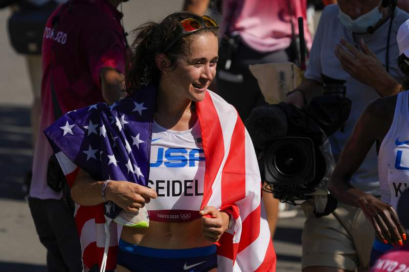 Molly Seidel, of United States, reacts after her third place finish in the women's marathon at the 2020 Summer Olympics, Saturday, Aug. 7, 2021, in Sapporo, Japan. (AP Photo/Shuji Kajiyama)