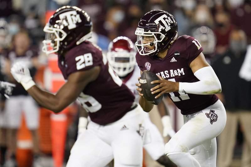 Texas A&M quarterback Kellen Mond (11) rushes against Arkansas during the first quarter of an NCAA college football game Saturday, Oct. 31, 2020, in College Station, Texas.