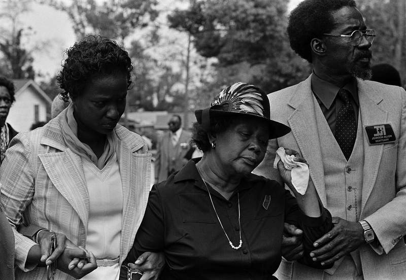 Beulah Donald, center, wipes tears from her eyes as she enters funeral services for her 19-year-old son Michael in Mobile, Alabama, March 28, 1981. Michael was found beaten and strangled to death, his body hanged from a tree on March 21. Three suspects have been arrested in connection with the brutal killing. (AP Photo/Mark Foley)