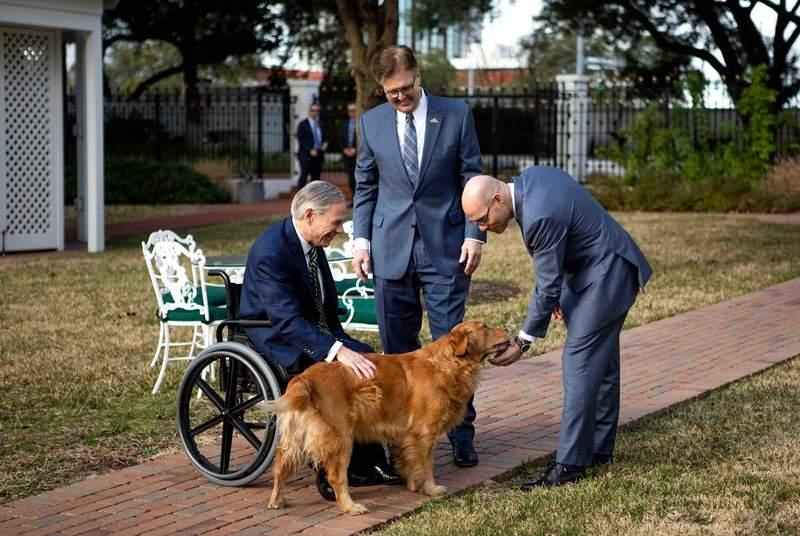 Governor Greg Abott, Lieutenant Governor Dan Patrick, and House Speaker Dennis Bonnen pet Pancake, the governors dog after their joint press conference. Jan. 9, 2019.