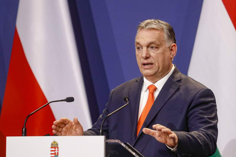 FILE - In this Thursday, April 1, 2021 file photo, Hungarian prime minister Viktor Orban speaks during a press conference in Budapest, Hungary. Hungarys parliament on Tuesday, April 27 voted to transfer state assets worth billions of dollars into foundations that will control many of the countrys public universities and cultural institutions. Opposition figures have decried the move as a theft of public funds, and the latest step in what critics call a takeover of Hungarys higher education system by Prime Minister Viktor Orban.(AP Photo/Laszlo Balogh, file)