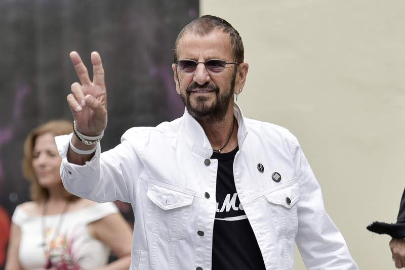 """FILE - Ringo Starr attends Ringo's 11th Annual Peace and Love birthday celebration on July 7, 2019, in Los Angeles. A bevy of stars including Paul McCartney, Sheryl Crow, Dave Grohl, Chris Stapleton, Lenny Kravitz and Jenny Lewis are all on the chorus of Starr's most recent song, """"Here's to the Nights."""" (Photo by Richard Shotwell/Invision/AP, FILE)"""