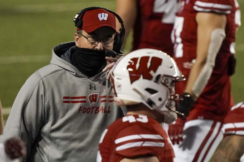 Wisconsin head coach Paul Chryst talks to players during the first half of an NCAA college football game against Illinois Friday, Oct. 23, 2020, in Madison, Wis. (AP Photo/Morry Gash)