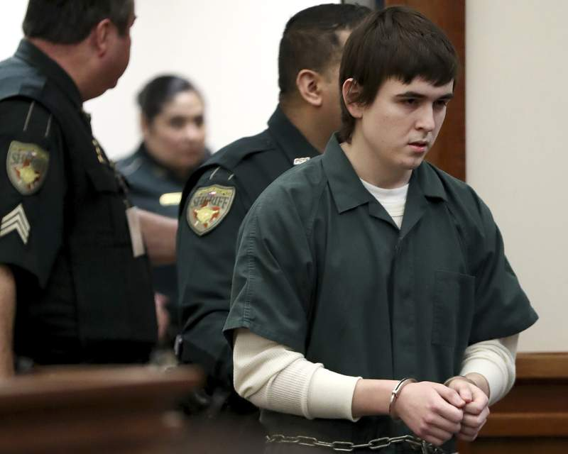 FILE - In this Feb. 25, 2019 file photo, Dimitrios Pagourtzis is escorted by Galveston County Sheriff's Office deputies into a courtroom at the Galveston County Courthouse in Galveston, Texas. Nick Poehl, one of Pagourtzis attorneys, says Pagourtzis, charged in a mass shooting at a Texas high school last year, has been declared incompetent to stand trial by three experts. Poehl said Monday, Nov. 4 a formal court order declaring him incompetent was expected later this week. (Jennifer Reynolds/The Galveston County Daily News via AP, File)