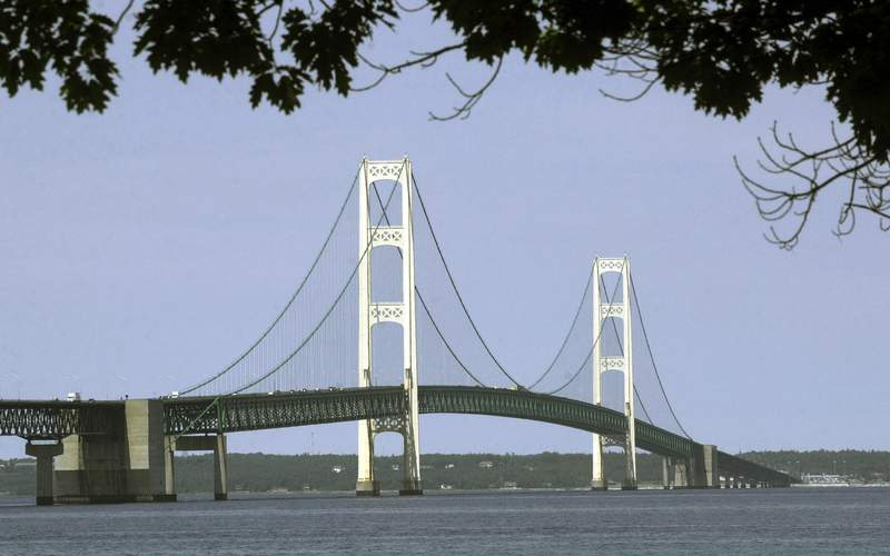 FILE - This July 19, 2002, file photo, shows the Mackinac Bridge that spans the Straits of Mackinac from Mackinaw City, Mich. Michigan's environmental agency said Friday, Jan. 29, 2021, it had approved construction of an underground tunnel to house a replacement for a controversial oil pipeline in a channel linking two of the Great Lakes. (AP Photo/Carlos Osorio, File)