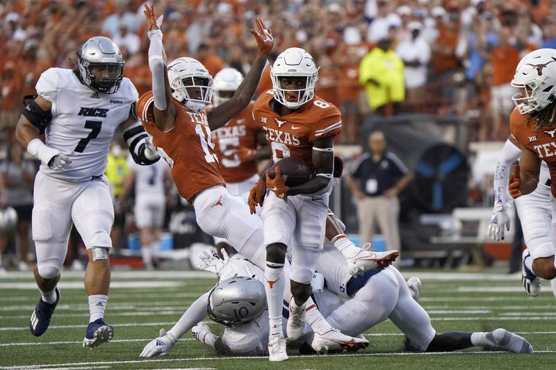Texas wide receiver Xavier Worthy (8) runs for a long gain against Rice during the first half of an NCAA college football game on Saturday, Sept. 18, 2021, in Austin, Texas. (AP Photo/Chuck Burton)