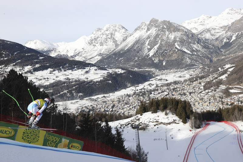 Switzerland's Carlo Janka speeds down the course during an alpine ski, men's World Cup downhill training, in Bormio, Italy, Sunday, Dec. 27, 2020. (AP Photo/Alessandro Trovati)
