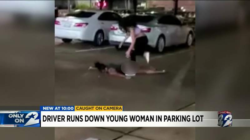 Driver runs down woman in parking lot