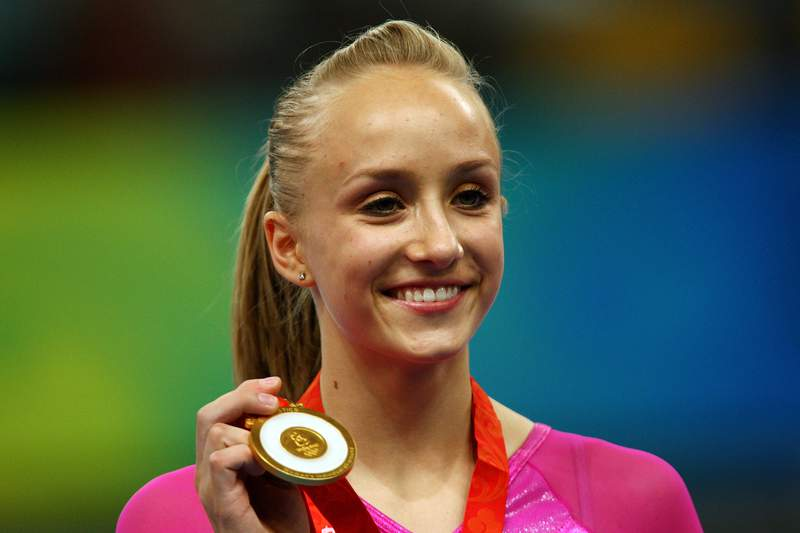 Nastia Liukin poses after winning the gold medal in the women's individual all-around artistic gymnastics final at the National Indoor Stadium on Day 7 of the Beijing 2008 Olympic Games on August 15, 2008 in Beijing, China. (Photo by Quinn Rooney/Getty Images)