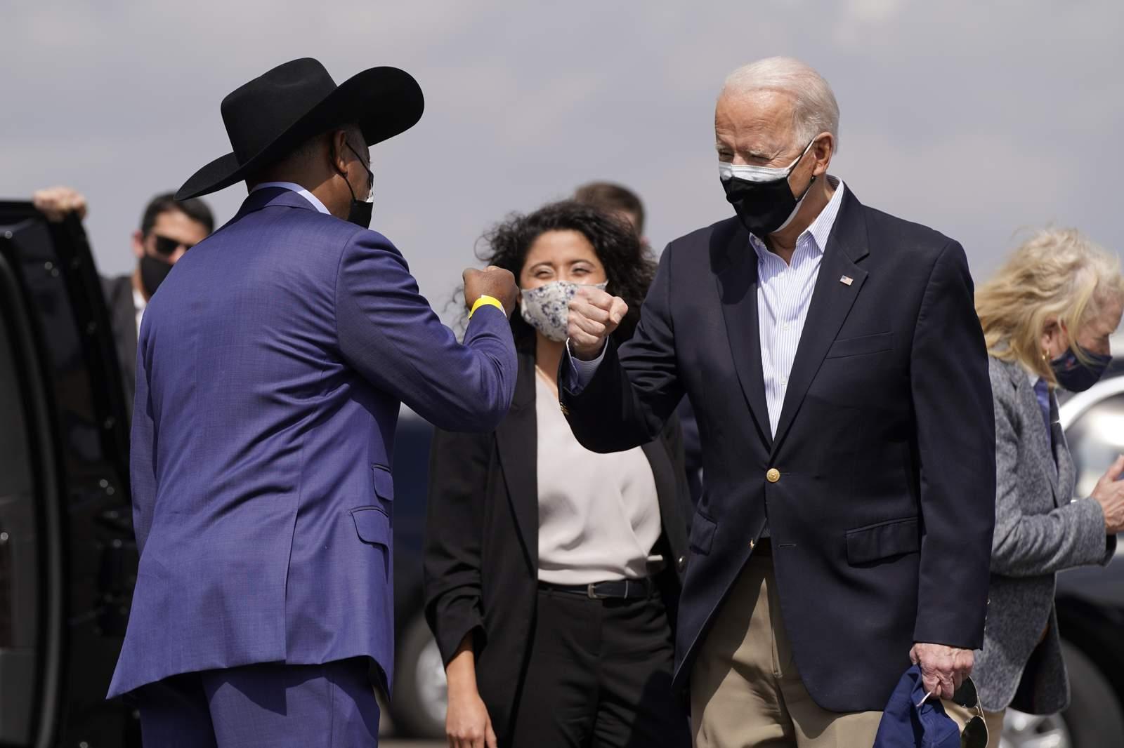 President Joe Biden greets Houston Mayor Sylvester Turner after stepping off Air Force One at Ellington Field Joint Reserve Base in Houston, Friday, Feb. 26, 2021. (AP Photo/Patrick Semansky)