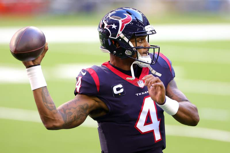 Deshaun Watson #4 of the Houston Texans in action against the Tennessee Titans during a game at NRG Stadium on January 03, 2021 in Houston, Texas. (Photo by Carmen Mandato/Getty Images)