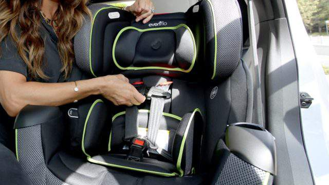 Ali Landry demonstrates how to install a car seat during Favord.bys 3rd annual Red CARpet Safety Awareness Event. (Photo by Rachel Murray/Getty Images for Evenflo)