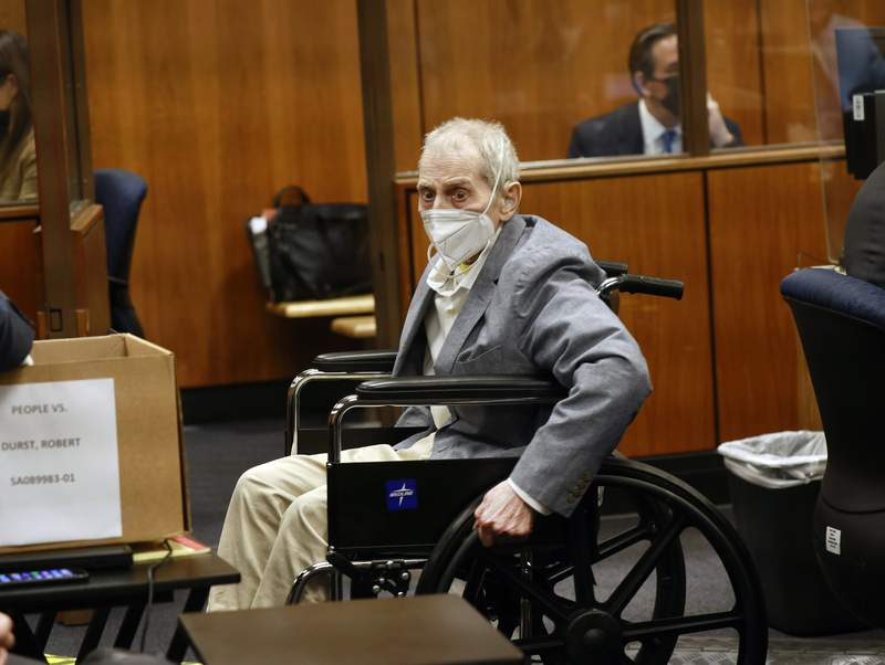 Robert Durst spins his wheelchair s in place as he looks at people in the courtroom in Inglewood, Calif. on Wednesday, Sept. 8, 2021, with his attorneys for closing arguments presented by the prosecution in the murder trial of the New York real estate scion who is charged with the longtime friend Susan Berman's killing in Benedict Canyon just before Christmas Eve 2000. (Al Seib/Los Angeles Times via AP, Pool)