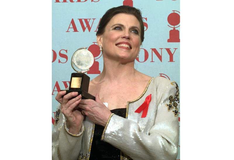 """FILE - Ann Reinking holds her Tony Award for best choreography for the musical """"Chicago"""" at the 51st annual Tony Awards on June 1, 1997, in New York.  A scholarship has been created in honor of the late Tony Award-winning dancer and choreographer Ann Reinking. It offers a $5,000 annual award and mentorship for a young dancer moving to New York City to help support them in their artistic endeavors. (AP Photo/Richard Drew, File)"""