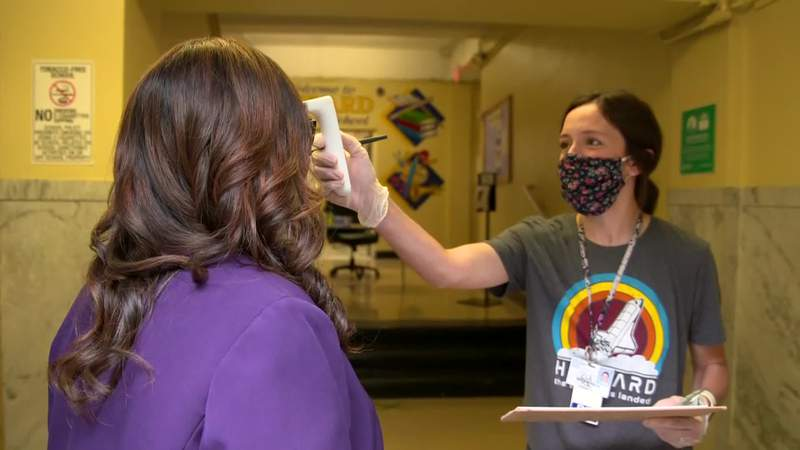At Harvard Elementary in Houston, everyone entering school will have their temperature checked and the district superintendent is wondering whether young children will be able to keep masks on all day.