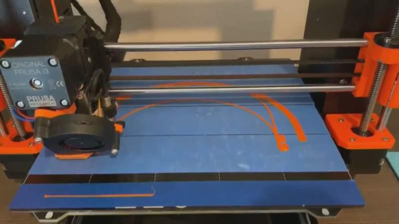 High School Robotics Team Making Equipment for Healthcare Workers