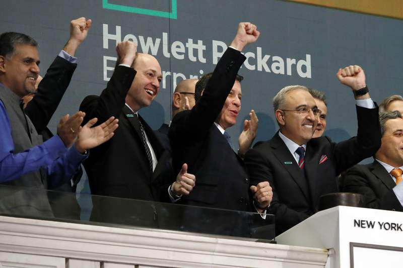 FILE - In this Wednesday, Oct. 24, 2018, file photo, Hewlett Packard Enterprise President & CEO Antonio Neri, right, rings the New York Stock Exchange opening bell. Tech giant Hewlett Packard Enterprise said it is moving its global headquarters to the Houston area from California. Texas Gov. Greg Abbotts office announced Tuesday, Dec. 1, 2020, that the relocation will increase the companys presence in the area, which is already home to more than 2,600 employees. (AP Photo/Richard Drew, File)